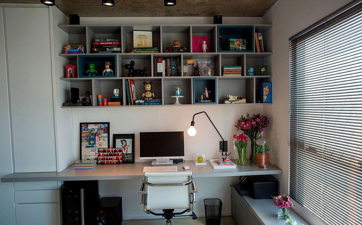 Modern home office with open bookshelf above workstation