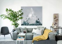 Modular sectional in living room in light bluish gray for the stylishly different bachelor pad 217x155 Nordic Influence: Posh Bachelor Pad Moves Away from Leather and Dark Finishes