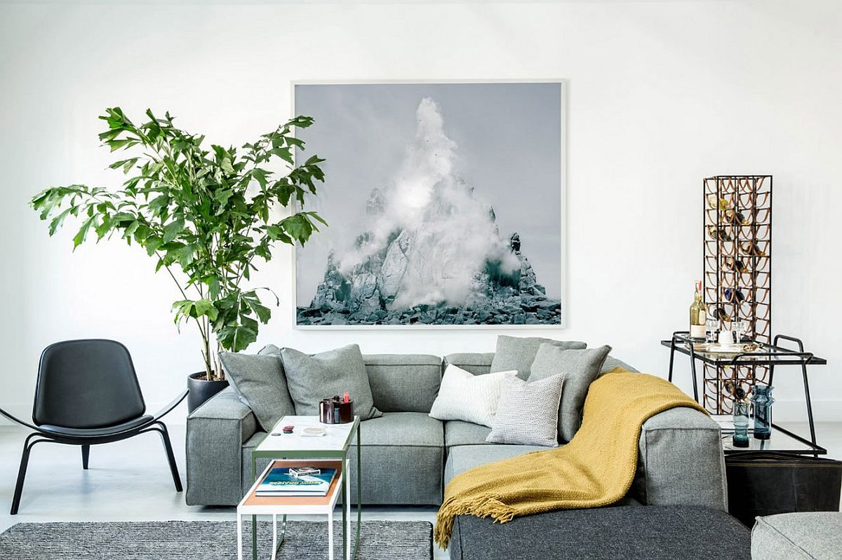 Modular sectional in living room in light bluish-gray for the stylishly different bachelor pad