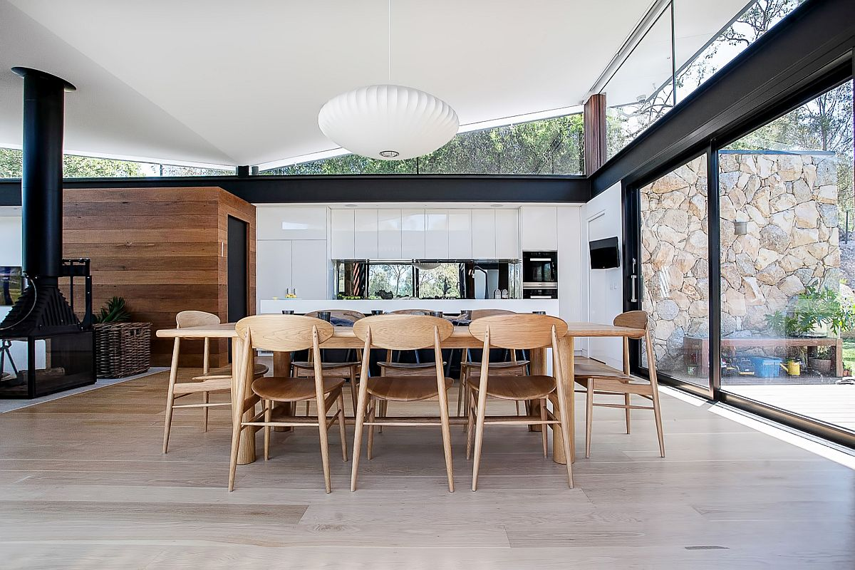 Nelson pendant adds midcentury glam to the residence in stone, glass and steel