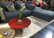 Nifty living room decor with colorful coffee table and a cool sectional from Tafaruci