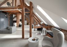 Old attic business space in Poznan turned into a spacious modern apartment 217x155 Beauty of Brick Walls and Timber Structure: Apartment in Poznan