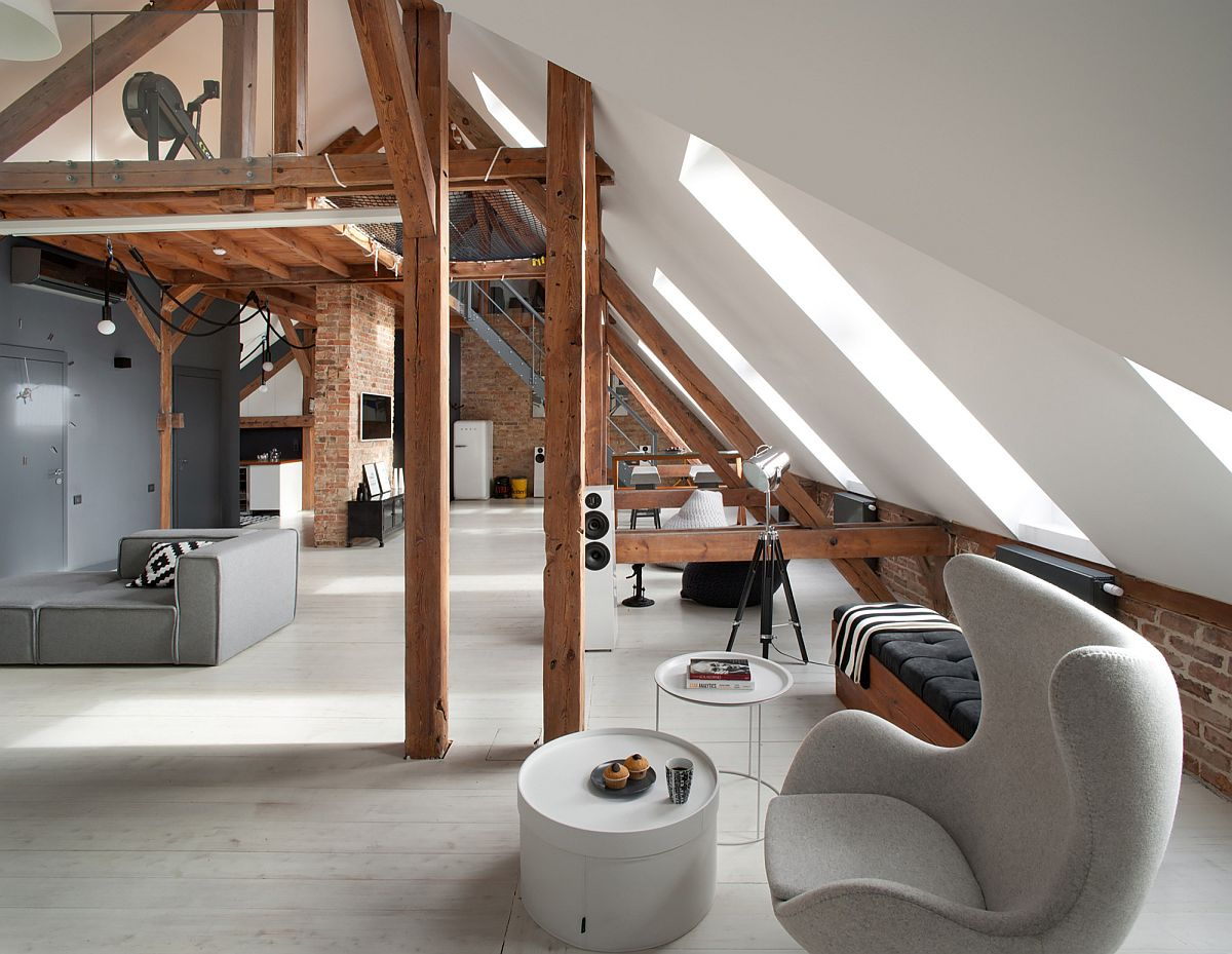 Old attic business space in Poznan turned into a spacious modern apartment