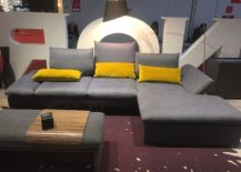 Opulent couch in gray with yellow accent pillows - Living room decorating ideas from Milan 2016