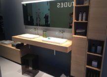 Organized-shelves-and-sleek-vanity-in-wood-for-the-modern-bathroom-217x155