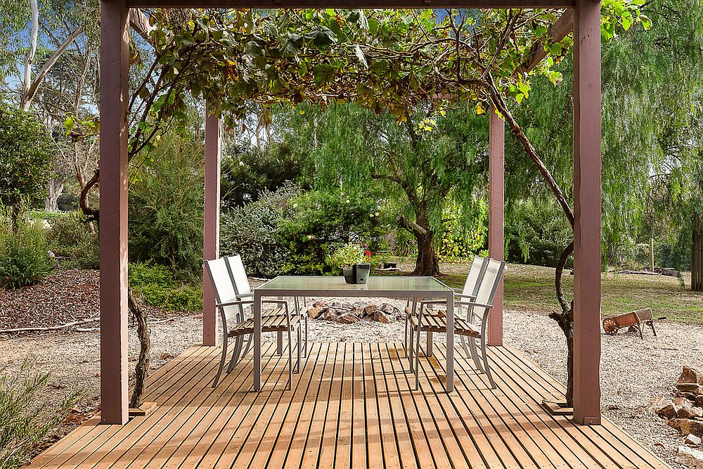 Pergola structure and outdoor dining space at the Bower House