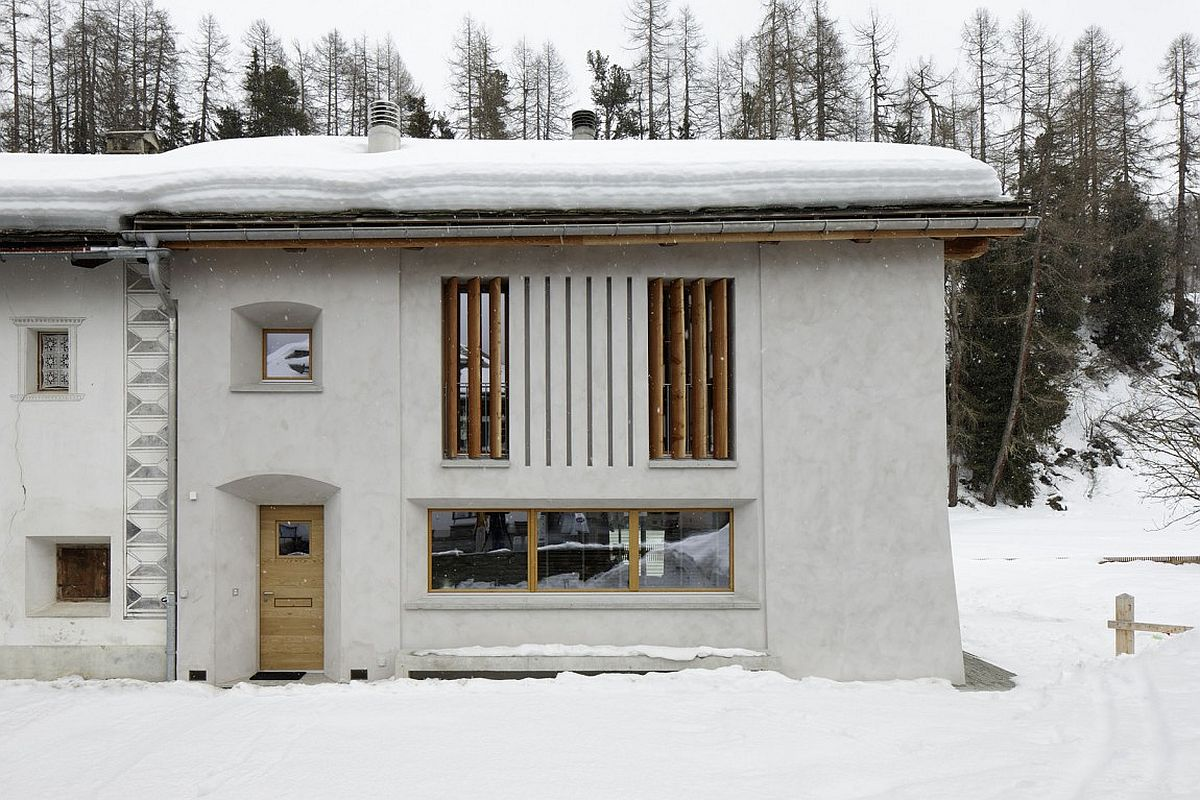 Plastered exterior walls and smart windows transform the old structure into a beautiful home