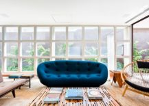 Plush and colorful couch in navy blue for the vivacious living space of AA House