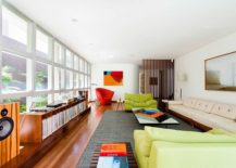 Pops-of-red-blue-and-green-enliven-the-living-space-with-glass-panes-217x155