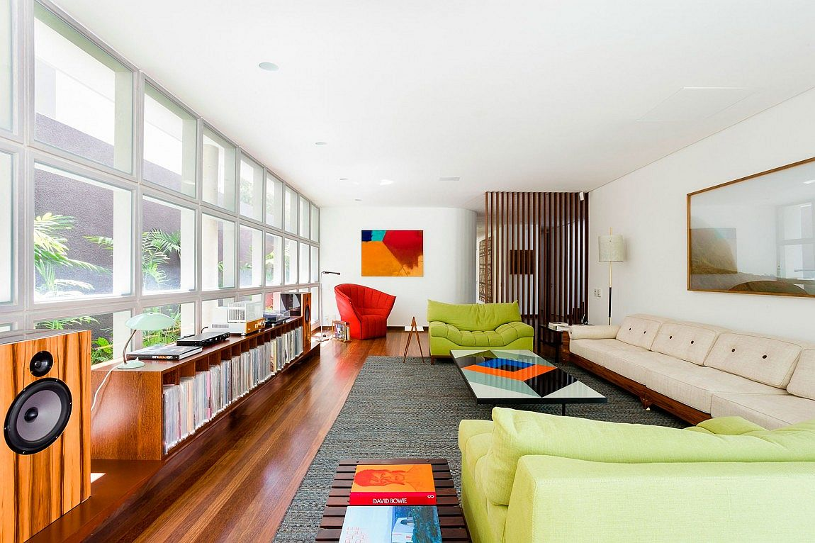 Pops of red, blue and green enliven the living space with glass panes