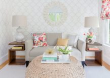 Pouf coffee table in a wallpapered room