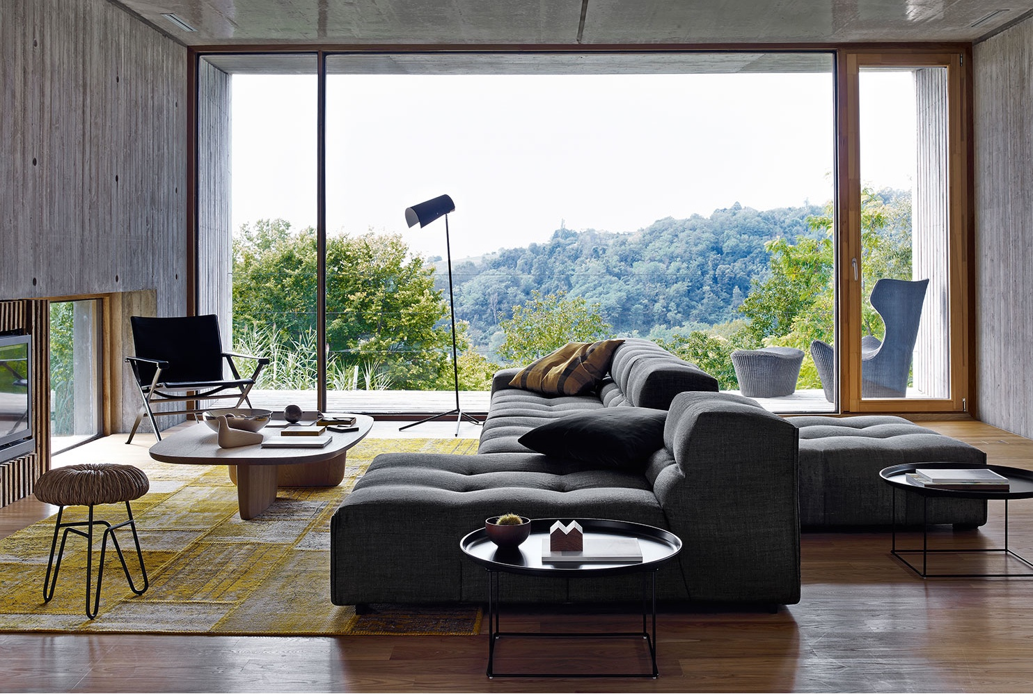B&B Italia was established in 1966 byPier Ambrogio Busnelli. In this image, products include theBeverly '14 armchair by Antonio Citterio and Patricia Urquiola's Tufty-Too sofa. Image© 2016 B&B ItaliaSPA.