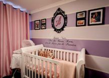 Purple and pink baby girl nursery with striped accent wall