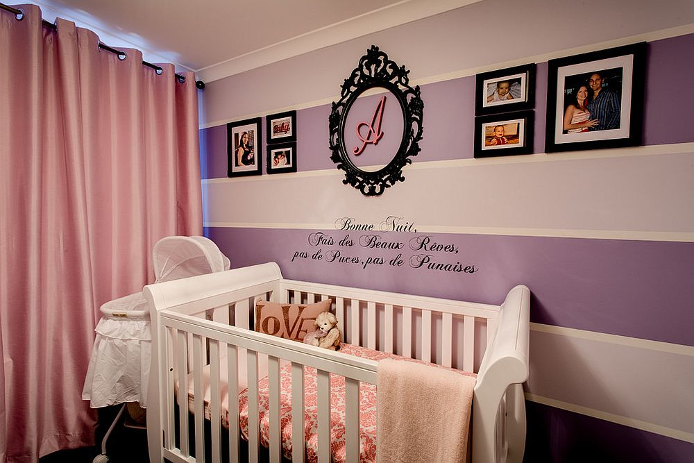 Purple and pink baby girl nursery with striped accent wall [Design: Interior Rejuvenations]