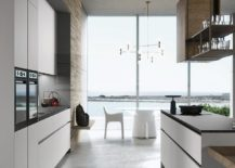 Recessed finger pulls and handleless doors shape a lovely minimal kitchen