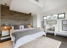 Relaxing bedroom with an accent wall of recycled wood