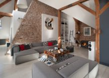 Restored original roof timber structure and brick walls of the Poznan apartment