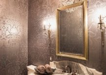 Rich Cole and Son's Malabar Wallpaper steals the show in this dashing powder room