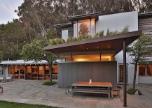 Rustic elements such as the pergola roof provide shade even while adding to the homes aesthetics 217x155 Ranch Style Santa Monica Home Draped in Pleasant Rustic Modernism
