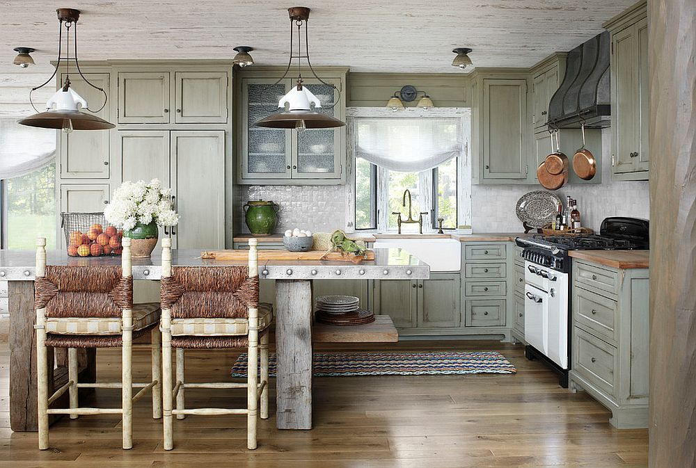 Rustic kitchen with a cool metallic central island [Design: Jessica Jubelirer Design]