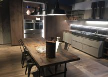 Rustic modern kitchen and dining space by Ernestomeda