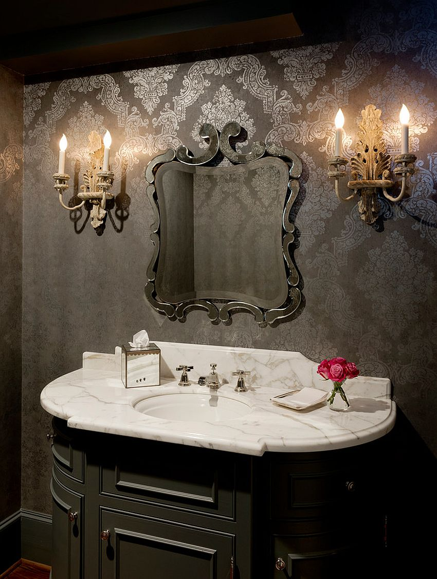 Sconce lighting and wallpaper bring Victorian style to this powder room [Design: Buster & Cogdell Builders]