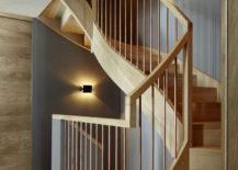 Sculptural staircase in oak with wooden handrail and copper railing