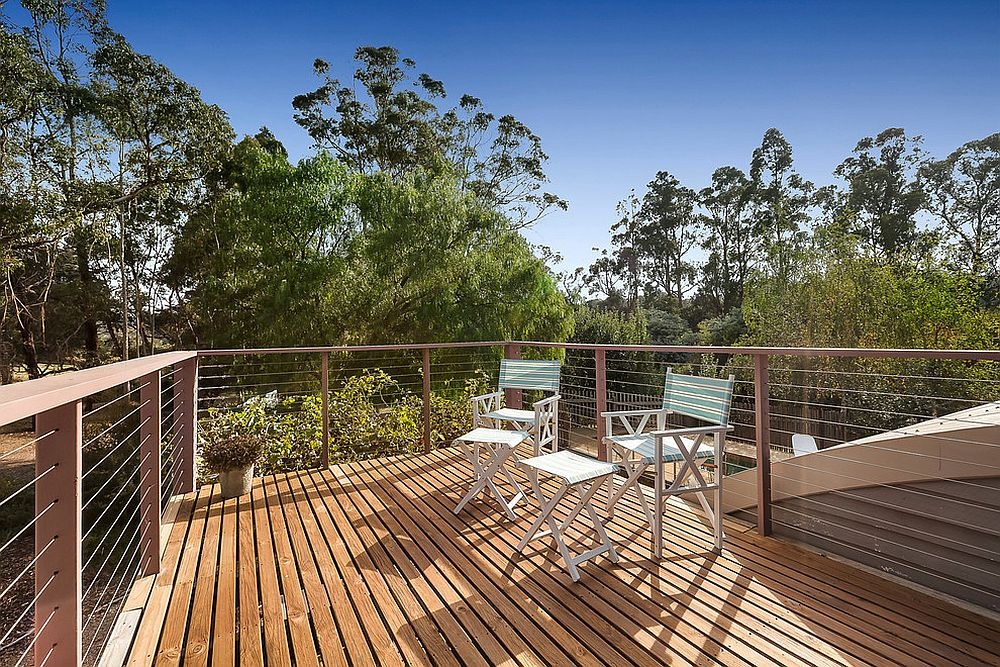 Simple and efficient beach style deck with an unabated view of the green landscape