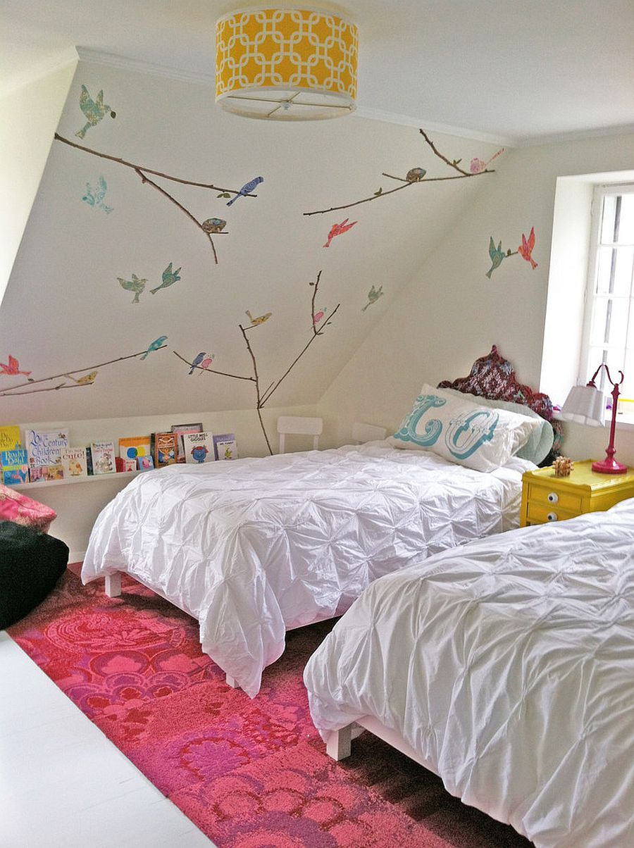 Simple wall decals add color and playfulness to the small kids' room [Design: Dichotomy Interiors]