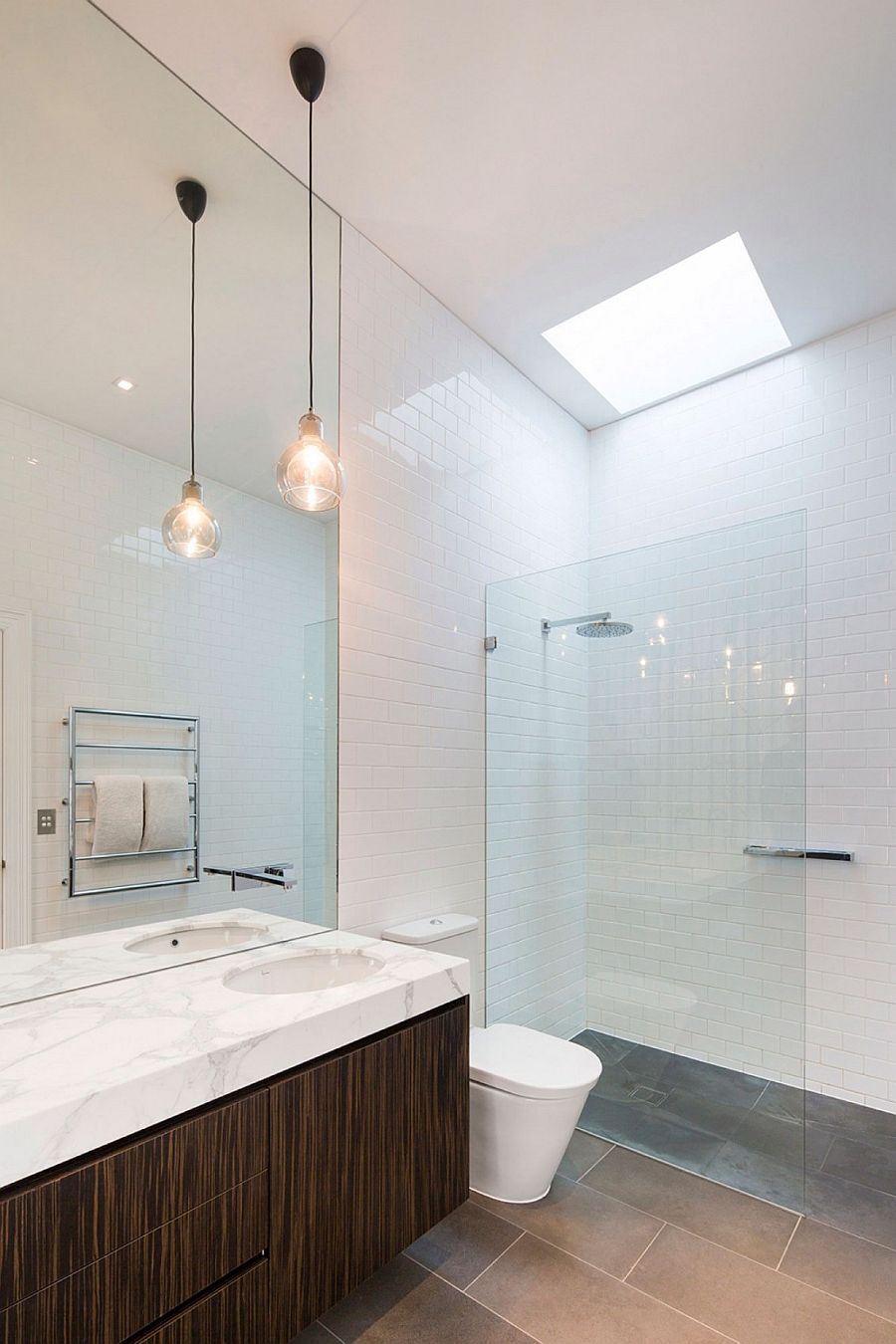 Skylight brings natural light into white, contemporary bathroom
