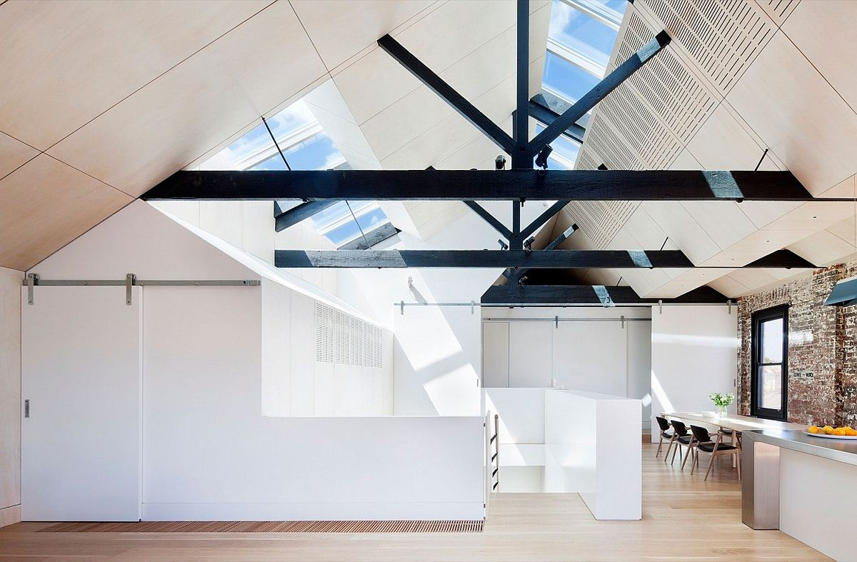 Skylights bring in sunlight to the top level of the house