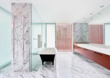 Sliding transluscent glass doors bring in natural light into the bathroom