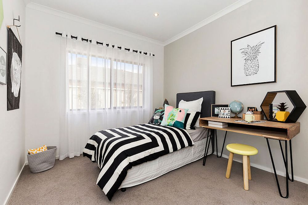 Small bedroom with a cool bedside table and workdesk