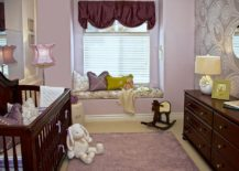 Small-nursery-seems-a-lot-more-spacious-thanks-to-the-plush-window-seat-and-mirrored-wall-behind-the-crib-217x155