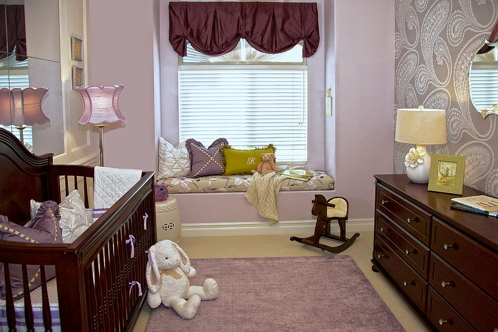 Small nursery seems a lot more spacious thanks to the plush window seat and mirrored wall behind the crib [Design: Rockabye Mommy / Jennifer Termini Photography]