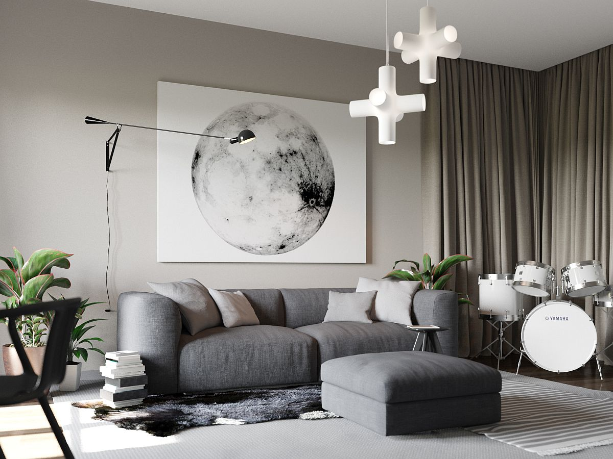 Smart sitting zone with plush couch and ottoman in gray and lovely wall art