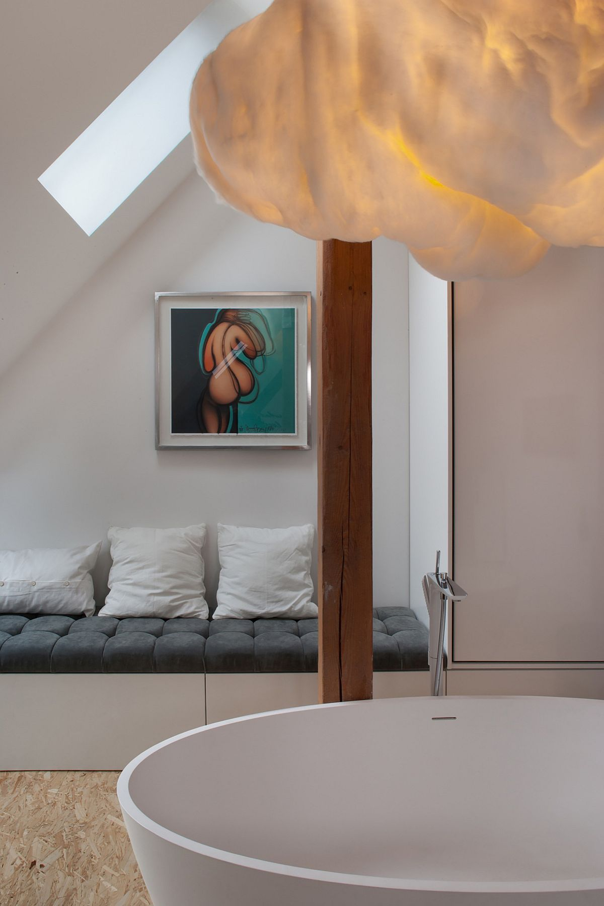 Soothing bathroom next to the bedroom with bathtub and cloud shaped lighting