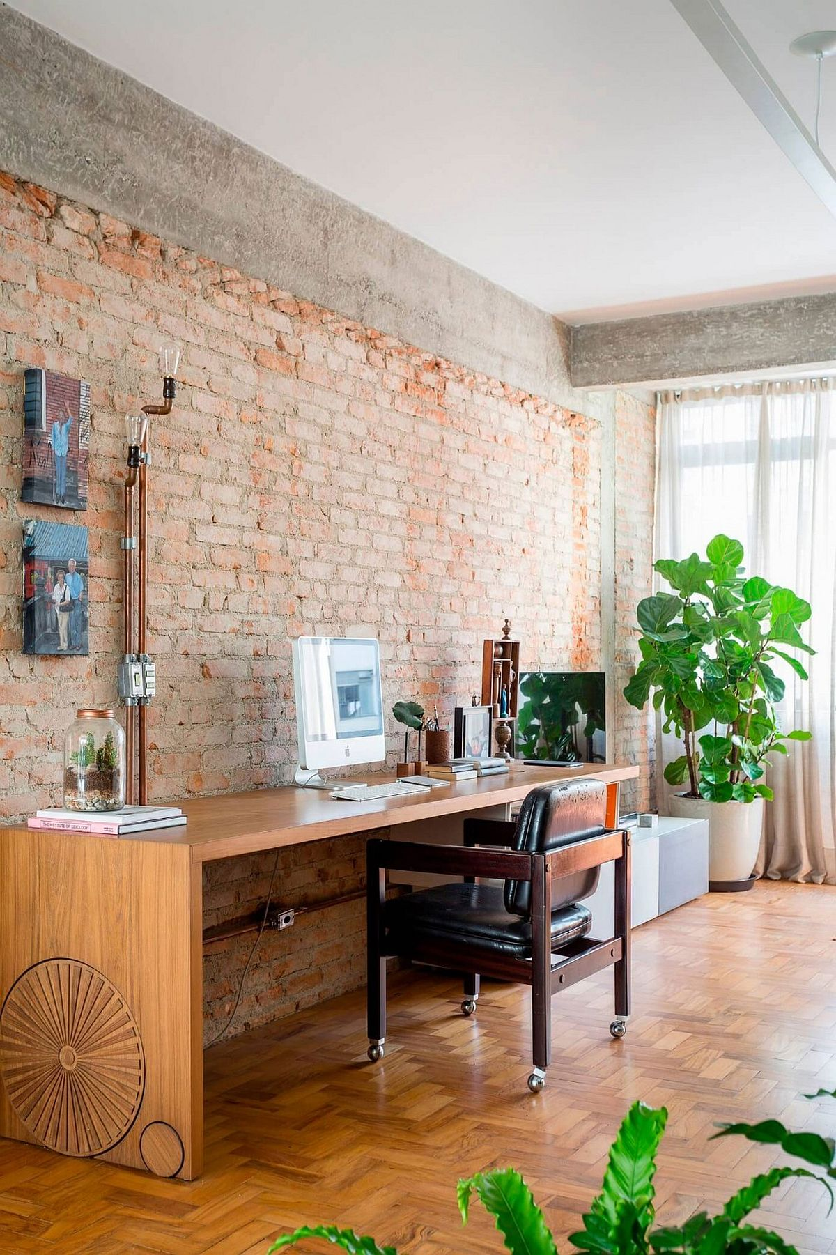 Spacious home workspace with brick walls