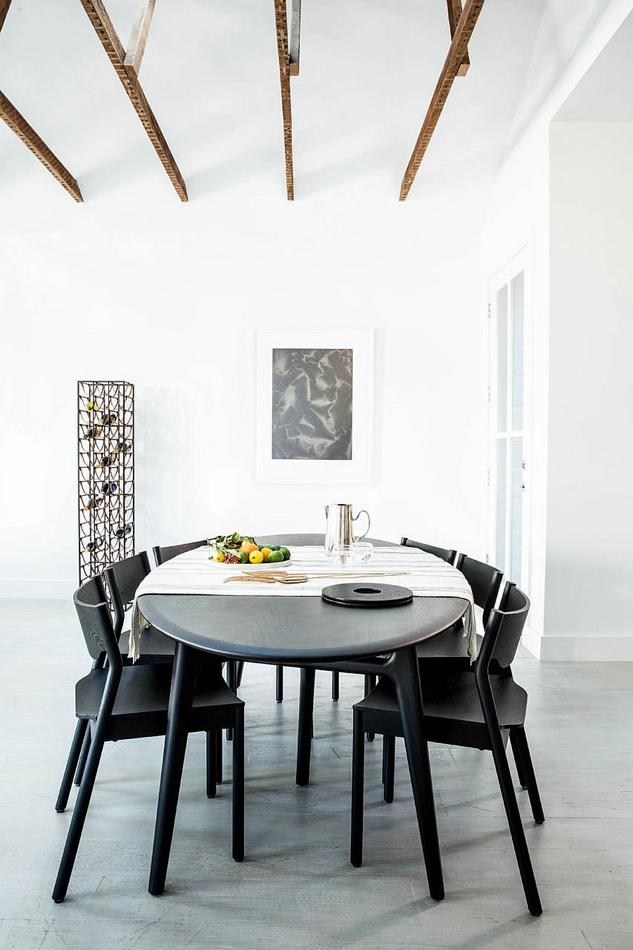Stackable dining table chairs offer a versatile decorating arrangement inside the apartment