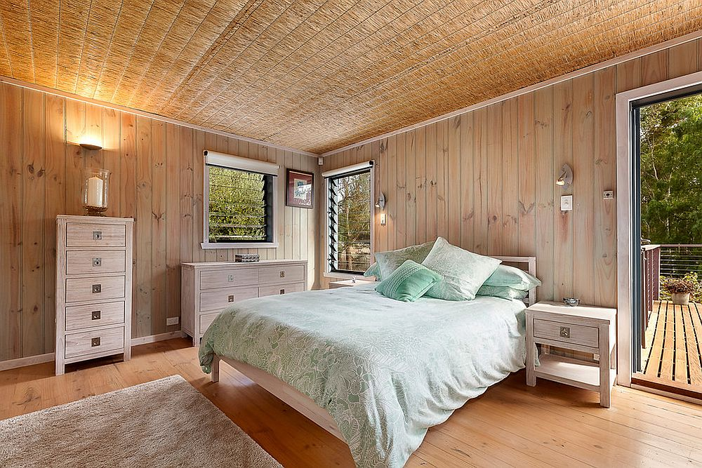 Straw ceiling is the showstopper inside the relaxing beach style bedroom