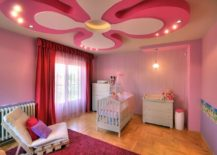 Stunning nursery in pink and purple with a ceiling design that is a showstopper