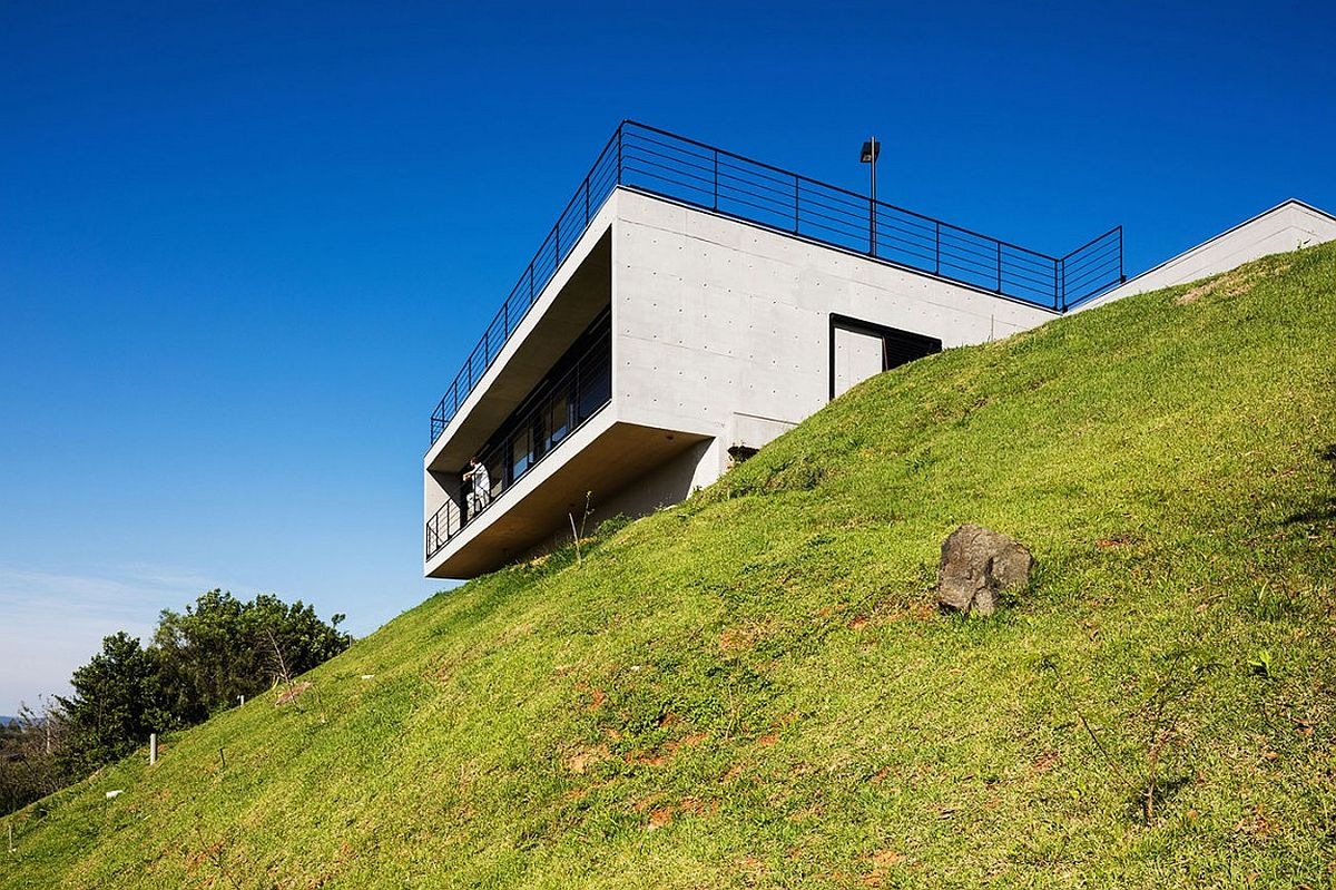 Stylish contemporary home located on a steep, hilly site in Brazil with amazing views