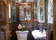Tile, wallpaper and metallic dazzle come together in this tiny powder room