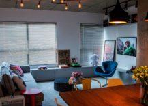 Tom Dixon pendant lights add class to the modest apartment