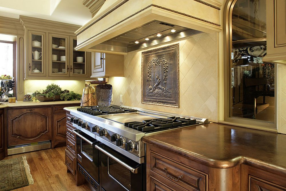 Tuscan kitchen with copper finishes is a timeless design that never disappoints [Design: Conrado - Home Builders]