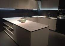 U-shaped kitchen design with open shelves for the peninsula and wall-mounted cabinets
