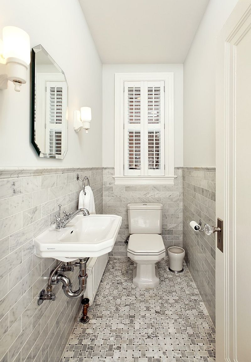 Ultra-narrow powder room relies on a monochromatic look for a spacious visual appeal [Design: Four Brothers]