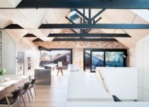 Upper-level-dining-area-and-kitchen-of-renovated-industrial-warehouse-home-217x155