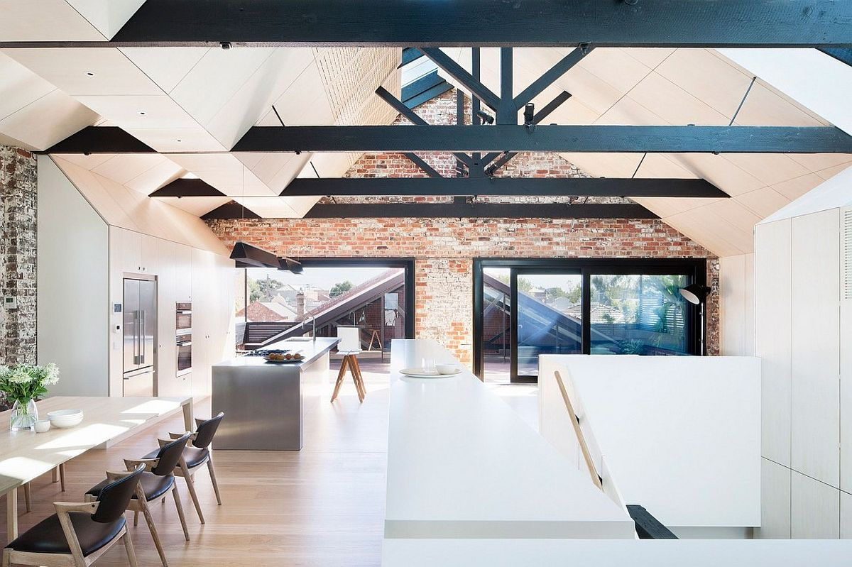 Upper level dining area and kitchen of renovated industrial warehouse home