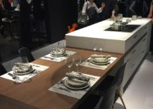 Versatile-kitchen-island-with-an-extended-dining-table-in-wood-by-Leicht-217x155